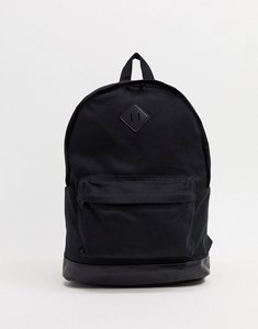 Read more about Asos design backpack in black canvas and faux leather