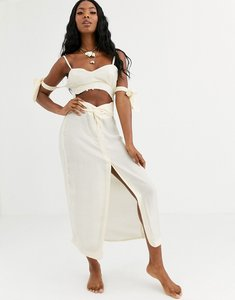 Read more about Asos design beach maxi dress in natural fabrication with cut out waist tie sleeves with shell trim-