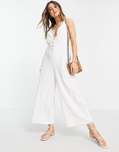 Read more about Asos design button front lace trim swing jumpsuit in white