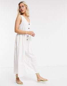 Read more about Asos design button front smock jumpsuit in white