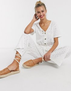 Read more about Asos design button front tie waist jumpsuit in broderie in white