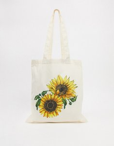Read more about Asos design canvas shopper with sunflower print-white