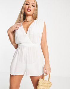 Read more about Asos design crinkle gathered plunge beach playsuit in white