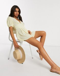Read more about Asos design crinkle tea playsuit with puff sleeve in lemon-yellow