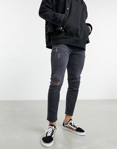 Read more about Asos design cropped skinny jeans with less thirsty wash in black with rips