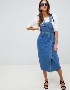Read more about Asos design denim midi dungaree dress in mid wash blue