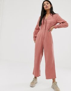 Read more about Asos design denim soft drape jumpsuit with longsleeve in terracotta-brown