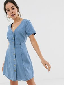 Read more about Asos design denim tea dress with mock horn buttons in blue