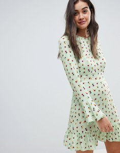 Read more about Asos design fluted long sleeve mini dress with pep hem in ditsy floral-multi