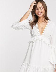 Read more about Asos design fluted sleeve open back skater mini dress with lace inserts in white