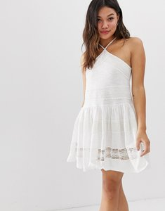 Read more about Asos design halter neck drop waist mini sundress with lace trim-white