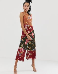 Read more about Asos design jumpsuit with high neck in mixed print-multi