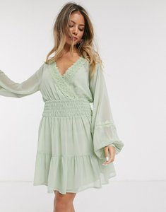Read more about Asos design lace insert shirred waist mini skater dress in sage green