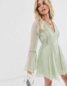 Read more about Asos design lace up mini dress with ladder trim-green