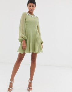 Read more about Asos design mini dress with embellished neckline-green