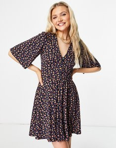 Read more about Asos design mini swing dress in navy floral print
