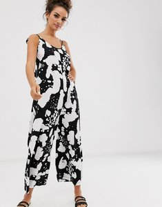 Read more about Asos design minimal jumpsuit with tie back in reverse mono print-multi