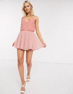 Read more about Asos design mixed sequin floaty playsuit in blush-yellow