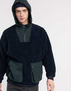 Read more about Asos design oversized half zip hoodie in teddy borg with tech pockets-navy
