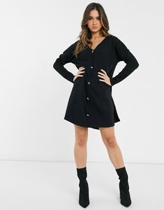 Read more about Asos design oversized smock dress with horn buttons in black