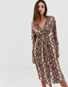Read more about Asos design relaxed long sleeve midi dress with knot front in snake print-multi