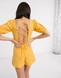 Read more about Asos design seersucker lace up back playsuit in yellow-multi