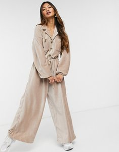 Read more about Asos design slouchy button front cord jumpsuit in tan-brown