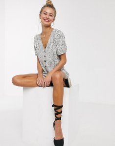 Read more about Asos design smock button front playsuit in mono spot print-multi