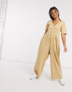 Read more about Asos design smock jumpsuit with button front in stone