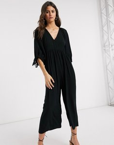Read more about Asos design smock jumpsuit with tie sleeve detail in black
