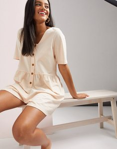 Read more about Asos design smock playsuit with button front in blush-pink
