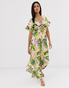 Read more about Asos design wide leg beach jumpsuit with cut out waist ring detail in pink palm print-multi