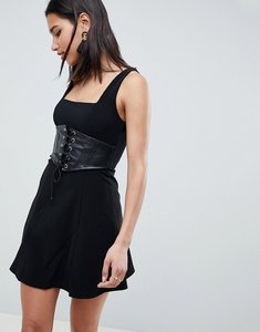 Read more about Asos premium rib mini skater dress with faux leather corset-black