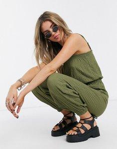 Read more about Bershka crinkle elasticated waist jumpsuit in khaki-green
