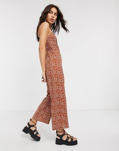 Read more about Bershka ruched front animal print jumpsuit in rust-orange