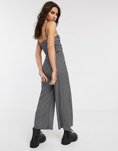 Read more about Bershka ruched front strappy gingham jumpsuit in monochrome-multi