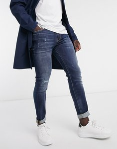 Read more about Calvin klein jeans skinny fit distressed jeans in mid wash-blue