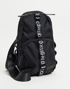 Read more about Consigned single stap mini backpack in black with white taping