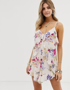 Read more about En creme floral playsuit with ruffle front detail-multi
