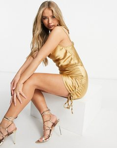 Read more about Femme luxe satin ruched tie side detail mini dress in gold