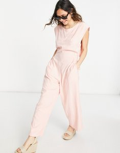 Read more about Free people heat wave relaxed jumpsuit in grapefruit-pink