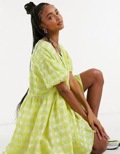 Read more about Glamorous oversized mini smock dress in neon check-green