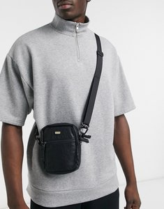 Read more about Grimey faux leather flight bag in black