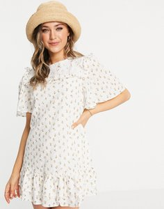 Read more about Just me frill hem mini dress in floral print-white