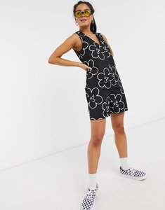 Read more about Lazy oaf relaxed button through playsuit in all over daisy print-black