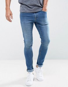 Read more about Ldn dnm super skinny spray on stretch jeans in midwash indigo-blue
