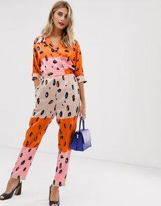 Read more about Liquorish jumpsuit with belt in contrasting orange leopard print-multi