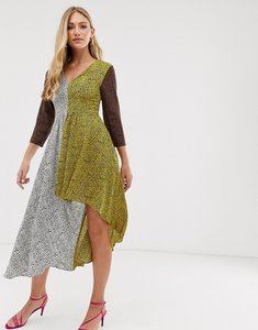 Read more about Liquorish v neck dress with hi-low hem in mixed animal print-multi