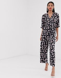 Read more about Liquorish wrap front jumpsuit in navy leopard print