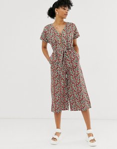 Read more about Monki jumpsuit with tie waist and button detail in red floral print-beige